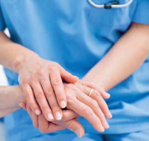 nurse holding hands with a patient